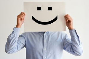 Career happiness with employee holding a blank paper and a smiley